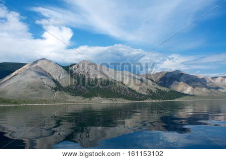 Clear day, blue sky on Baikal lake with mountains