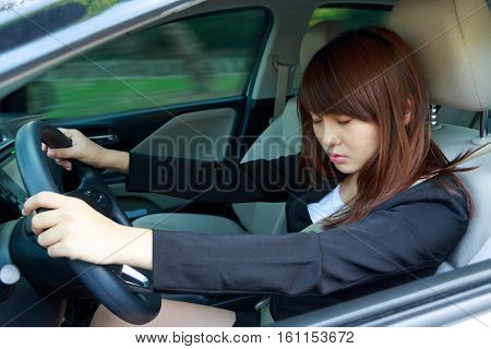 Closeup portrait sleep tired close eyes young woman driving her car after long hour trip Sleep deprivation accident concept