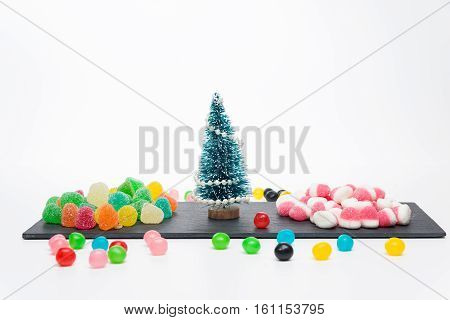 Christmas tree with candies isolated on white background