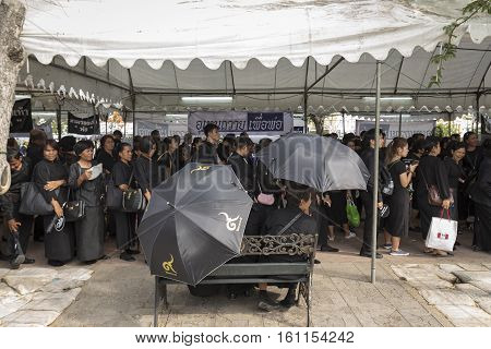 BANGKOK THAILAND - NOV 5 : standing mourners in sanam luang for queue into Grand Palace while the funeral of king Bhumibol Adulyadej on november 5 2016