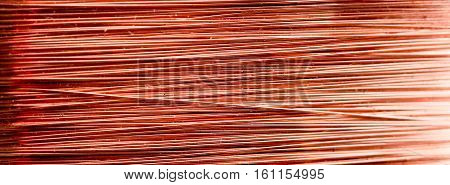 picture of a detail of a copper inductor in a transformer. macro shot in studio