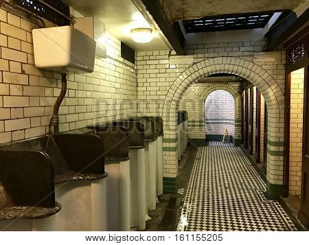 LONDON - DECEMBER 11: Listed Victorian male public toilets with marble and tiling at South End Green, Hampstead Heath on December 11, 2016 in Hampstead, London, UK. Built by George Jennings in 1897.