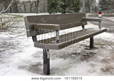 frozen bench and icy landscape in a public park Oregon state.