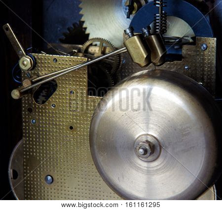Mechanism of mantel clock with brass chimes and small bronze hammers