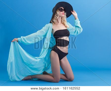 Sensual young woman in beach costume. Young sexual girl on a beach