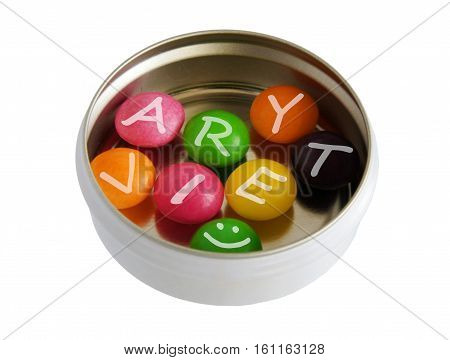 Color pills with letters in pillbox as the concept of variety of the world
