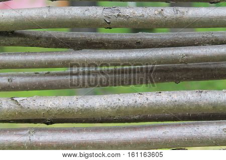 Background from wattled branches. Wooden fence texture