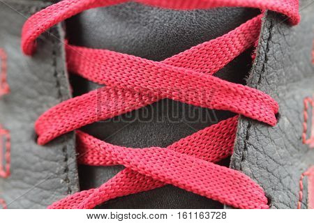 Red laces and red shoes. Macro, background