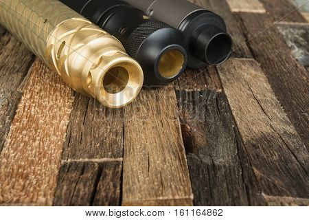 Modern electronic mech mod vaping device. Electronic cigarette on a wooden background.