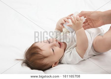Mother feeding baby from bottle, closeup
