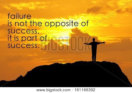 Inspirational Motivating Quote On Silhouette Of A Man Open Hands On Top Of Mountain During Sunset.