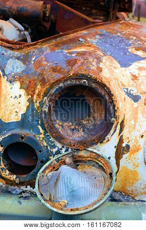 Classic car inundated with rust taken in a junkyard