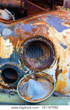 Classic car inundated with rust taken in a junkyard