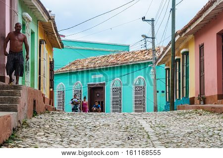 TRINIDAD, CUBA - MARCH 23, 2016: Local people approaching on the cobblestone streets in the UNESCO World Heritage old town of Trinidad Cuba
