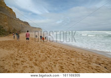 PORT CAMPBELL, AUSTRALIA - MARCH 11, 2014: Coastal landscape of Port Campbell National Park, tourists visiting the Twelve Apostles by the Great Ocean Road