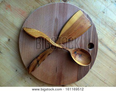 Wooden spoon, kitchen spatula made of Karelian birch. Cutting board. Handmade. Russian folk crafts. Vaalam. Close-up