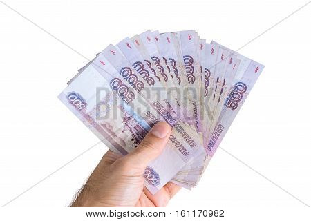 Banknotes are in denominations of 500 rubles in hand