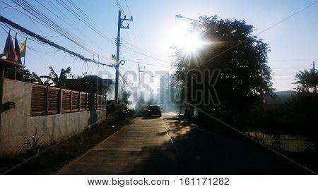 Fantastic outdoor sunrise,Sunrise serenity,Winter serenity,Road Under Sunrise Sunbeams,Vintage,Toned Instant Photo
