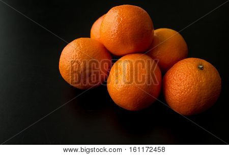 Pile Of Six Clementine Oranges, From Side