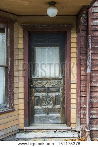 A beautiful detailed old door entrance to an abandoned old hotel.