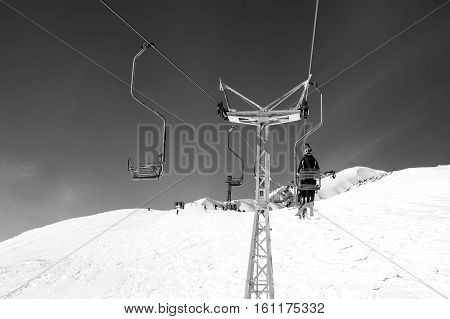 Black and white view on old chair-lift and off-piste at ski resort. Caucasus Mountains mount Cheget Elbrus region.