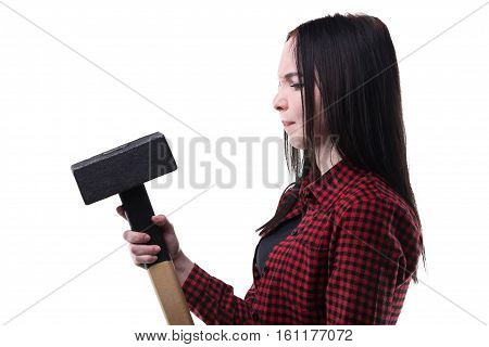 Puzzled brunette with big hammer on white background