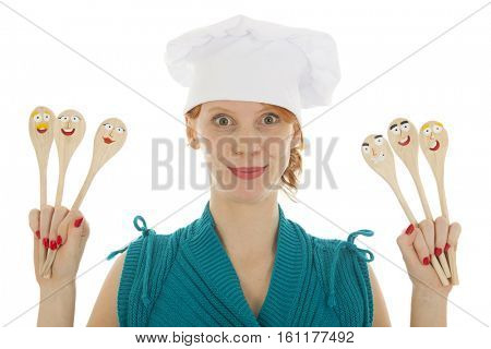 Woman cooking with funny wooden spoons and toque hat