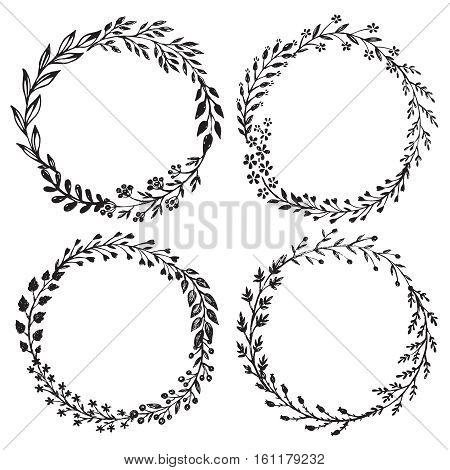 Set of hand drawn floral wreaths with leaves, flowers, berries. Vector round frames. Decorative elements for design in black and white sketch style.