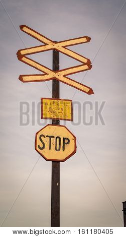 Antique railway crossing sign in rural Romania