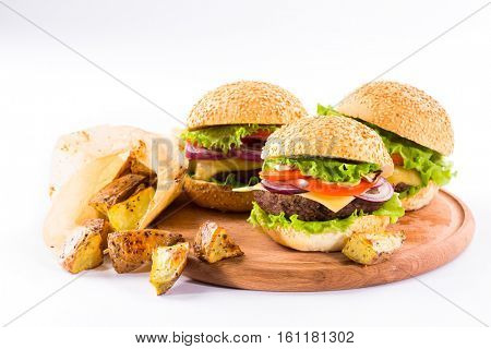 homemade burgers with beef and fried potatoes on white background