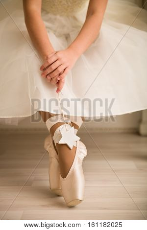 Legs of young ballerina ballet dancing. A photo of ballerina's pointes.