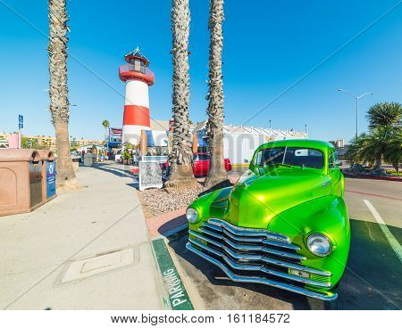 Classic car by Oceanside lighthouse in California