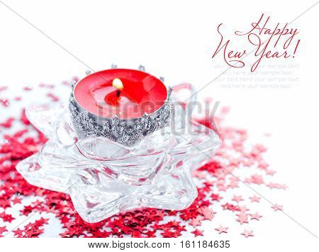 Christmas candle on red spangles asterisks. Christmas concept