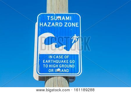 close up of a tsunami hazard zone sign in Los Angeles California