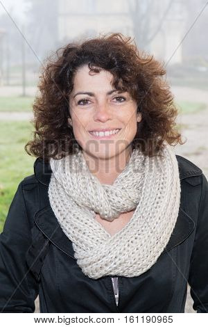 So Pretty Brunette Woman Forties In A Parc In Winter Day