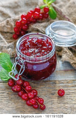 Homemade Jam In A Jar, Red Currant And Old Sacking.