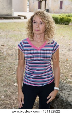 Blonde Senior Woman Making Sport In Outdoor Garden Or Park In City