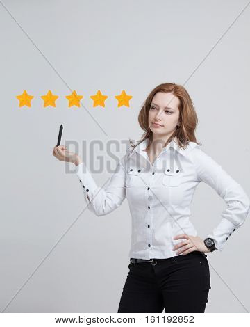 Five star rating or ranking, benchmarking concept. Woman assesses service, hotel, restaurant