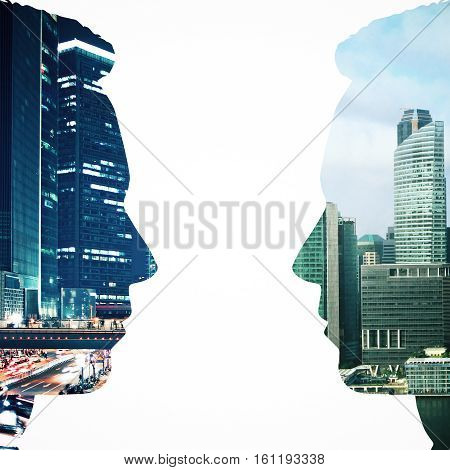 Two male head silhouettes facing each other on night city background. Communication concept. Double exposure