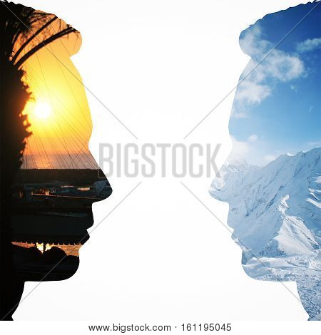 Two male head silhouettes facing each other on vacation city and snowy mountains background. Communication concept. Double exposure