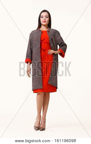 slavic business executive woman with streight hair style in casual coat and red dress full body photo high-heeled shoes isolated on white