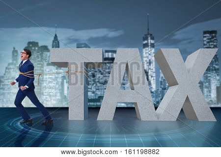 Businessman suffering from high taxes