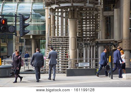 LONDON, UK - 17 May, 2016: Business people in front of Lloyds bank building in the City of London. Modern business life of capital