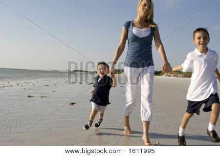 Mom With Kids On A Beach