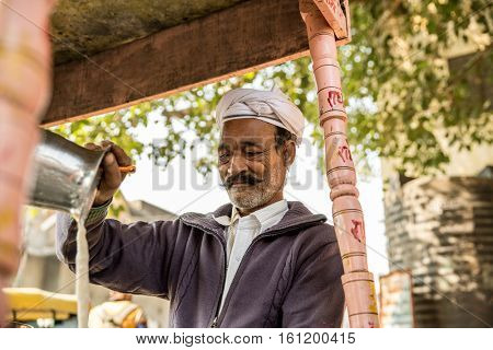 Muslim Indian preparing Masala Tea