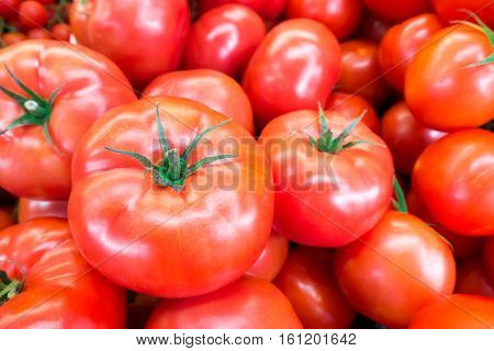 Close Up Of Fresh, Juicy, Ripe Tomatoes Pile. Lycopene And Antioxidant In Fruit Nutrition Good For H