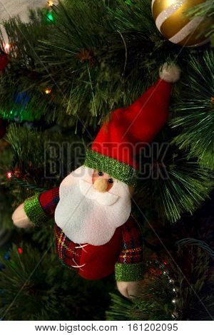 santa clouse at Christmas tree with garland and gifts at home