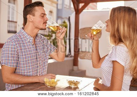 Charming Young Couple Sharing Some Drinks
