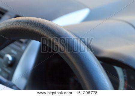 Steering wheel close up. Automobile detail. Transportation