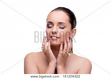Young woman showing off jewellery isolated on white
